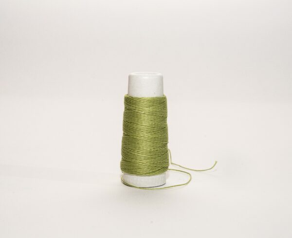 an image of a green spool of thread