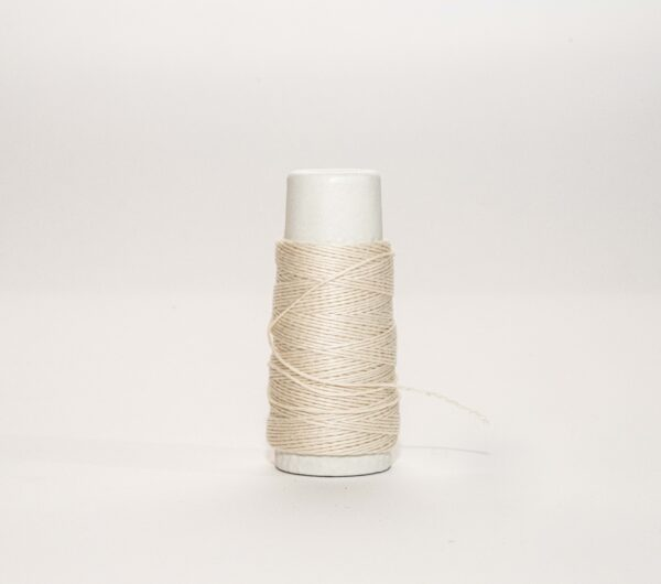 an image of an ivory spool of thread