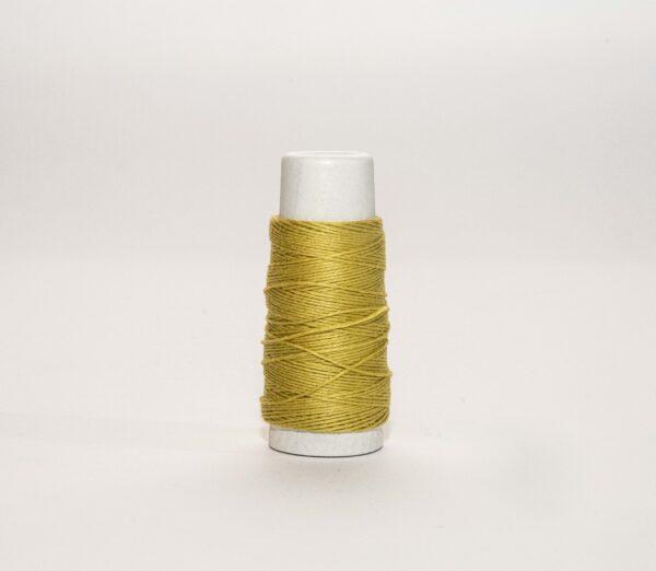 a spool of yellow thread