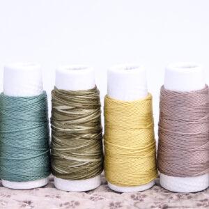 an image of 6 spools of sashiko thread