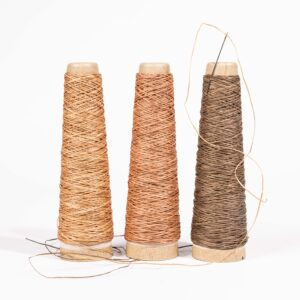 an image of three cones of cotton yard/thread