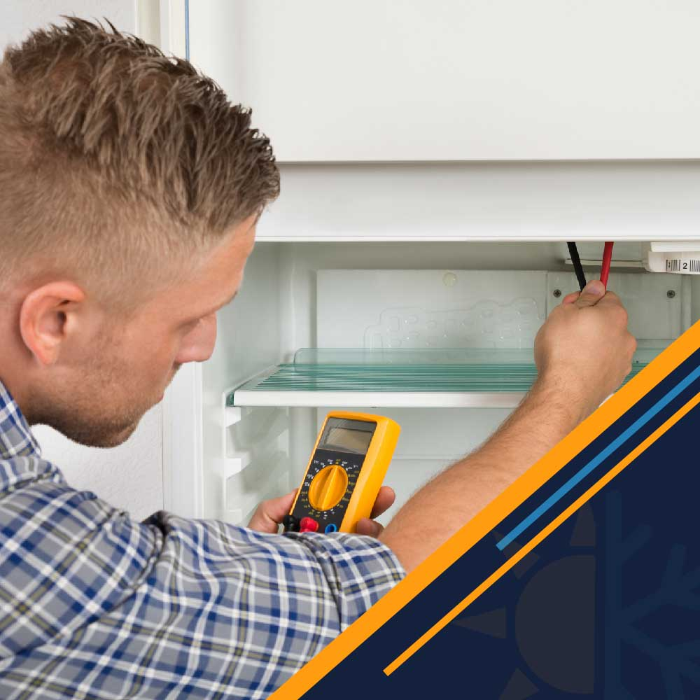 Technician-Checking-Fridge-With-Multimeter-Jeb-Air-houston-tx