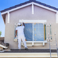 man_painting_house