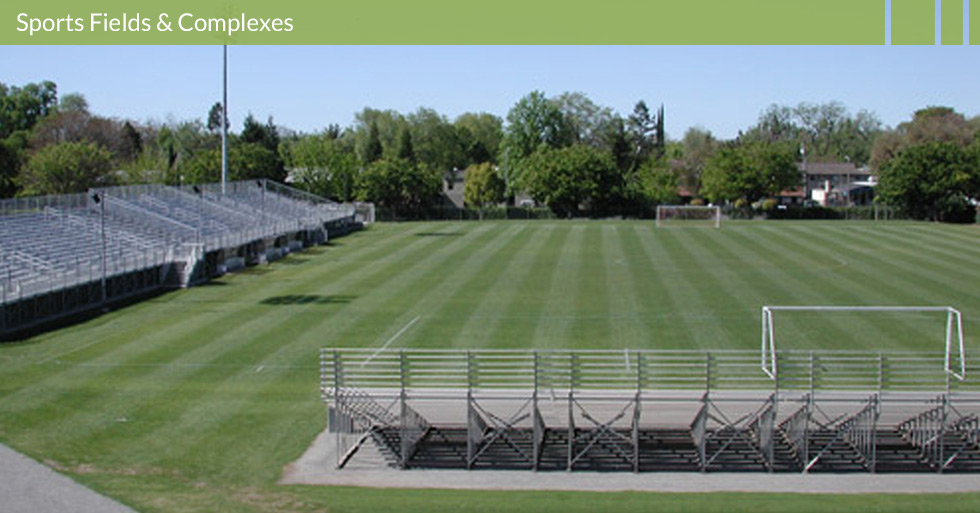 Melton Design Group, a landscape architecture firm, designed the Chico State Soccer Complex in Chico, CA. This large field is bordered by wood and chain link fences completed with plenty of seating in the bleachers for fans!