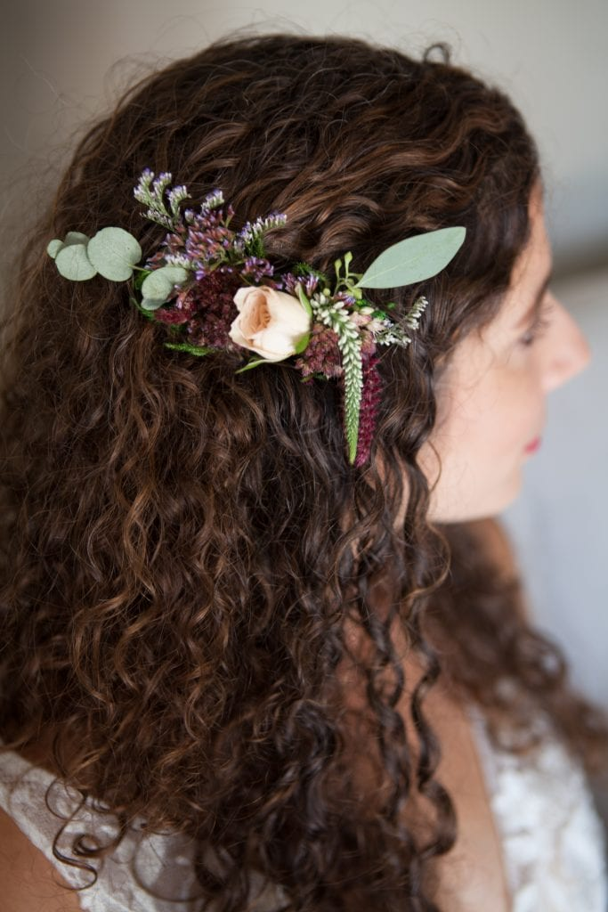 McCall Weddings Floral creates custom floral hair pieces for bride