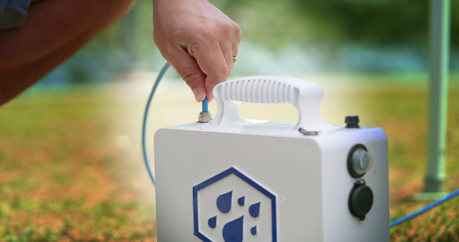 Attach the misting line to the output valve on top of the MISTER COOLER unit.