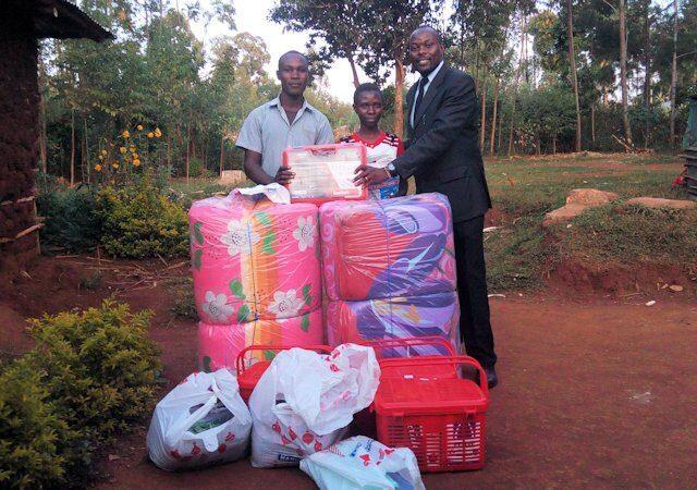 Mark Okello delivering supplies for Jirani Project children