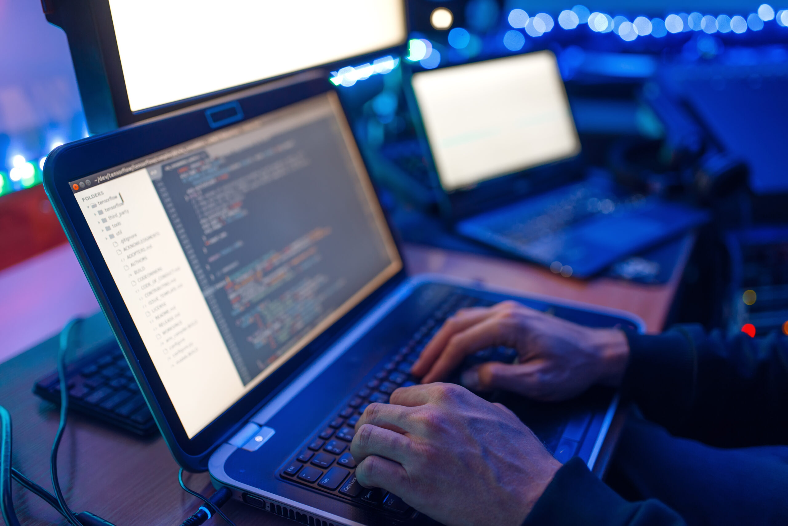 programmer hands on keyboard network security RRWPEHR scaled