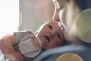 baby boy and mother looking at each other tenderly