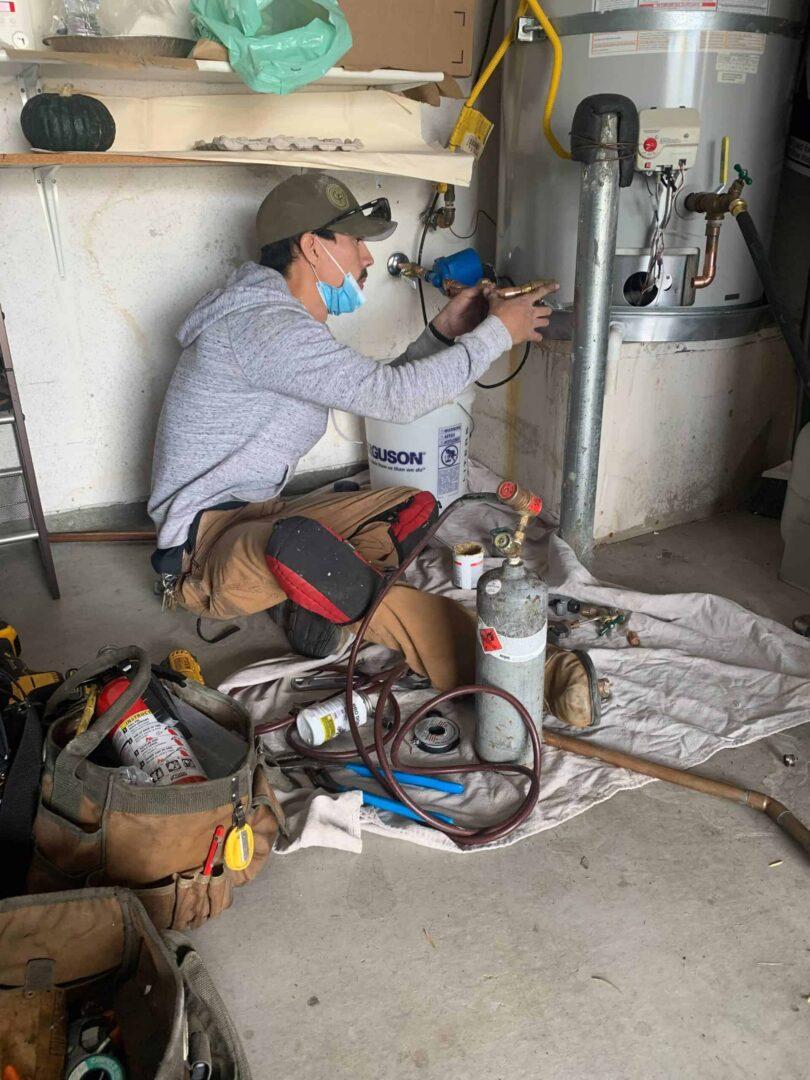 engineer repairing water heater