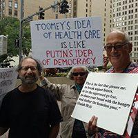 "Toomey protestor carrying sign ""Toomey's idea of healthcare is like Putin's idea of democracy"" via @lisajwardle | Twitter"