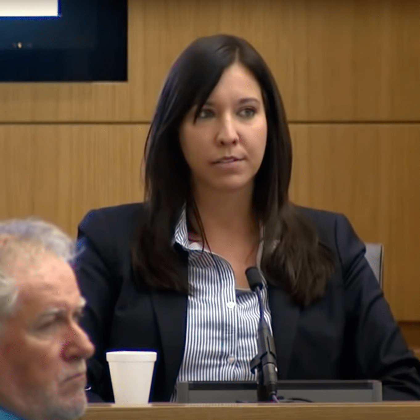 Dr. Janeen DeMarte on the witness stand providing expert testimony.
