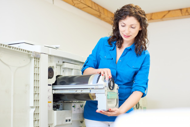 charming-woman-fixing-printer_236854-9354