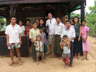 Charlie with a group of people in Myanmar