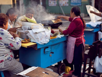 people eating at food cart