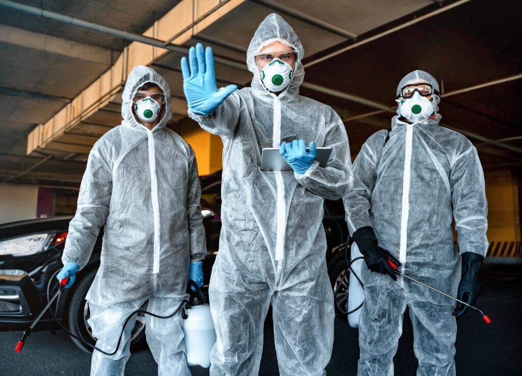 QM Employees on Hazmat Suits