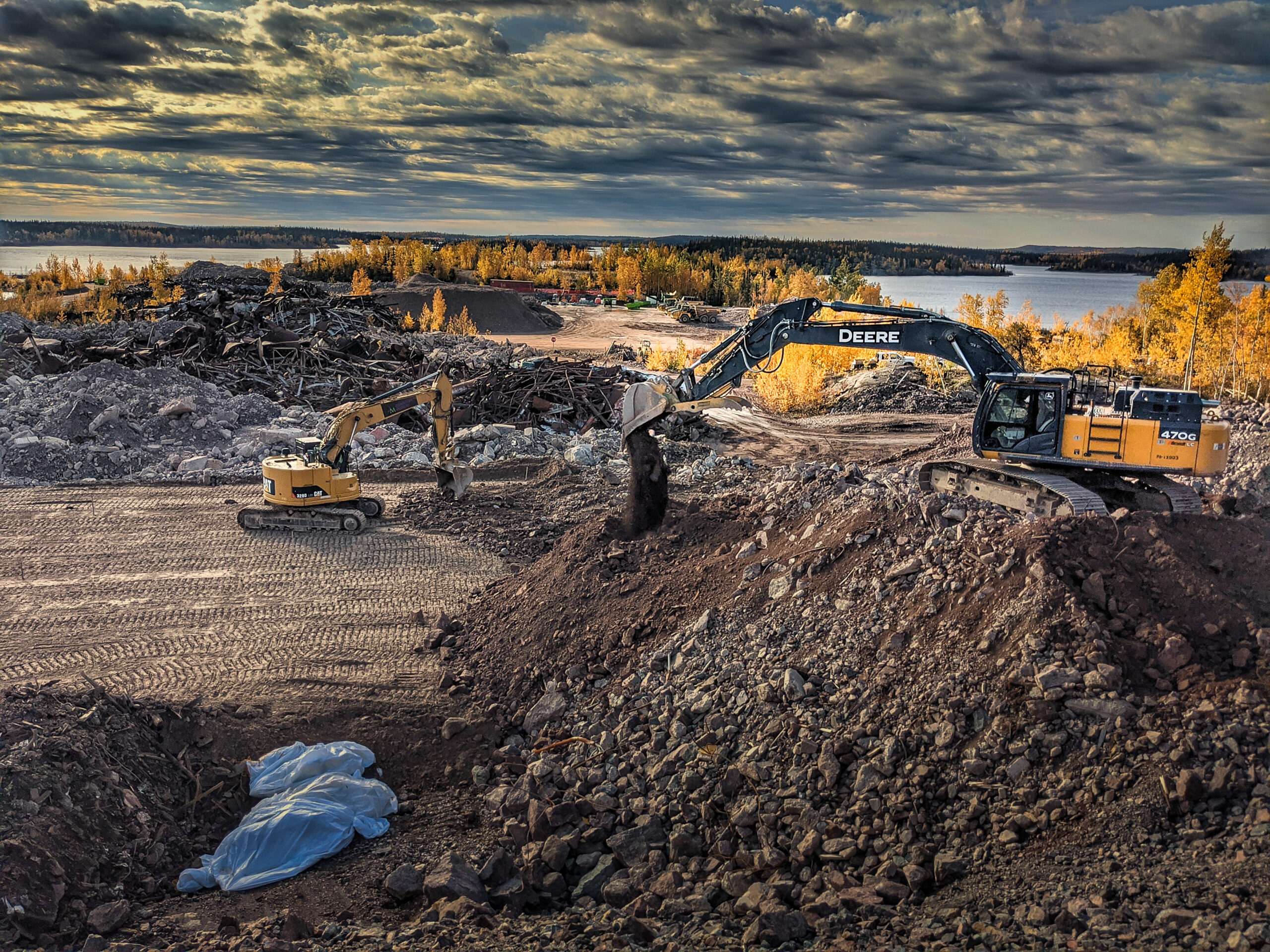 Landfill with excavator