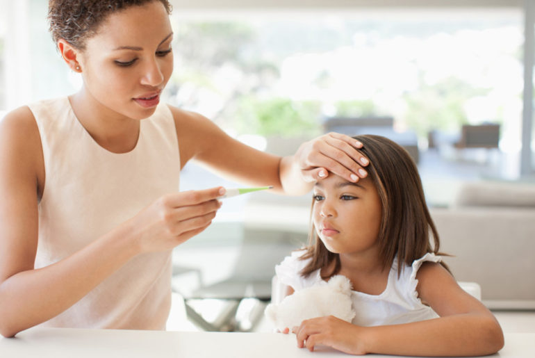 How To Keep Kids Safe From The flu, mom cares for sick kid