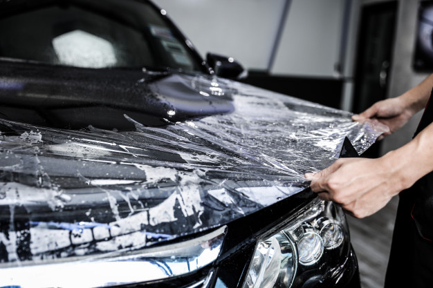 close-up-paint-protection-film-installation-front-bumper-modern-luxury-car-ppf-is-polyurethane-film-applied-car-surface-protect-paint-from-stone-chips-bug-splatter-abrasion_38076-2009