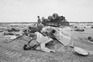 28 Apr 1972, Outside Quang Tri City, South Vietnam --- Outside Quang Tri City, So. Vietnam: An ARVN tries to extricate wounded civilians from debris after truck loaded with refugees struck a mine four miles south of Quang Tri. At least 40 persons were killed and 60 injured in the incident involving three different vehicles. --- Image by © Bettmann/CORBIS