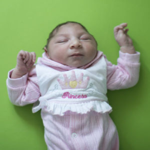 Sophia, who is two weeks old and was born with microcephaly, sleeps before her physical therapy session at the Pedro I hospital in Campina Grande, Paraiba state, Brazil, Friday, Feb. 12, 2016. The Zika virus, spread by the Aedes aegypti mosquito, is suspected to be linked with occurrences of microcephaly in new born babies, but no link has been proven yet. (AP Photo/Felipe Dana)