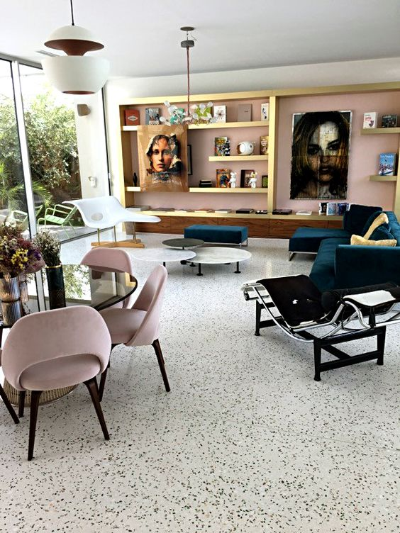 a-refined-living-room-with-a-white-terrazzo-floor-a-pink-wall-built-in-shelves-and-chic-modern-furniture
