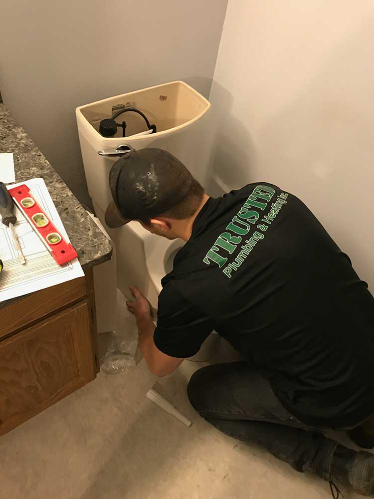 Trusted Plumbing and Heating Hard At Work Fixing plumbing in Regina and Area