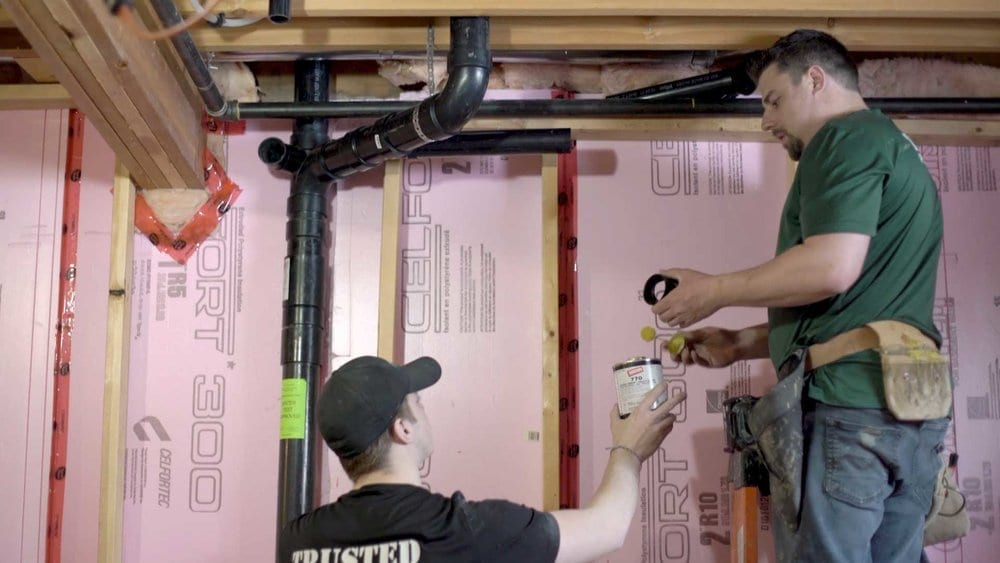 Trusted Plumbing and Heating employees working together to fix your plumbing