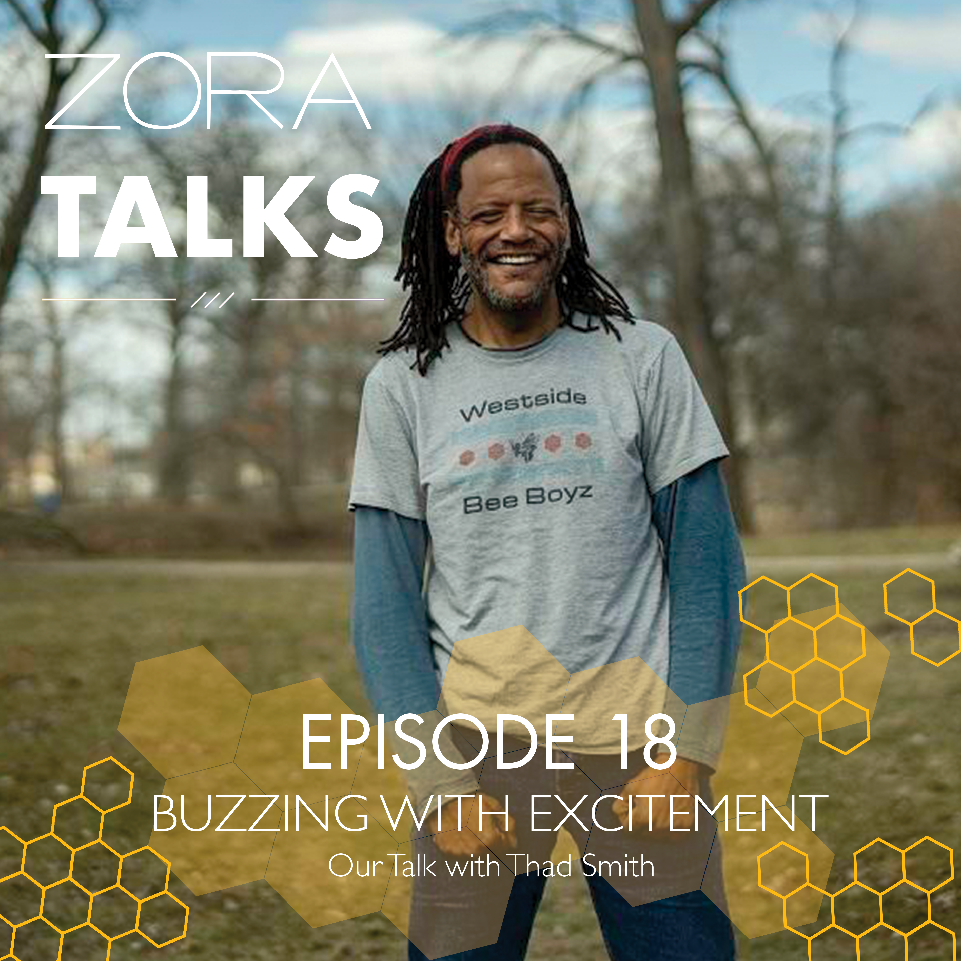 Man standing in a field smiling brightly. Zora Talks written over photo