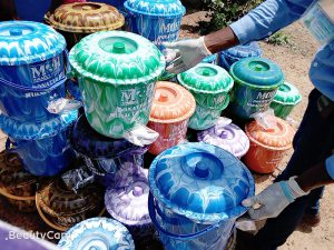 Hand washing buckets with spigots and lids being distributed to the villagers of Ngolahun.