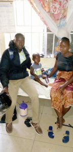 Musa with mother and MOH staff in hospital