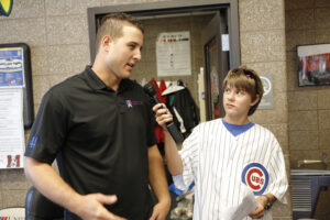 Aaron Hanania interviewing Cubs First baseman Anthony Rizzo in 2015