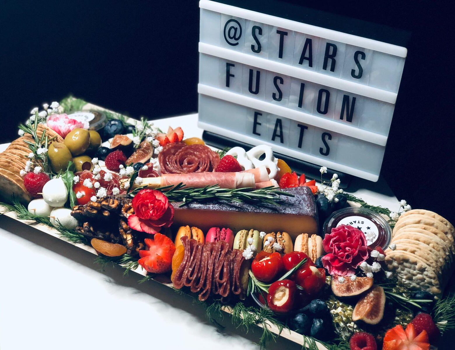 """""""Stars Fusion Eats has the BEST Charcuterie in the GTA. We specialize in gourmet snacking and luxury gifts. We provide a large variety of artisanal premium local products to create a custom gourmet snacking experience or luxurious gift to enjoy.  We create stylist custom pieces regardless of the audience. We provide the following options: Halal, Gluten-Free, Vegan, Vegetarian, Keto-friendly and more! So, enjoy upscale charcuterie with yourself, a loved one, your family for game night or a night in with your friends with the help of us, Stars Fusion Eats!"""""""