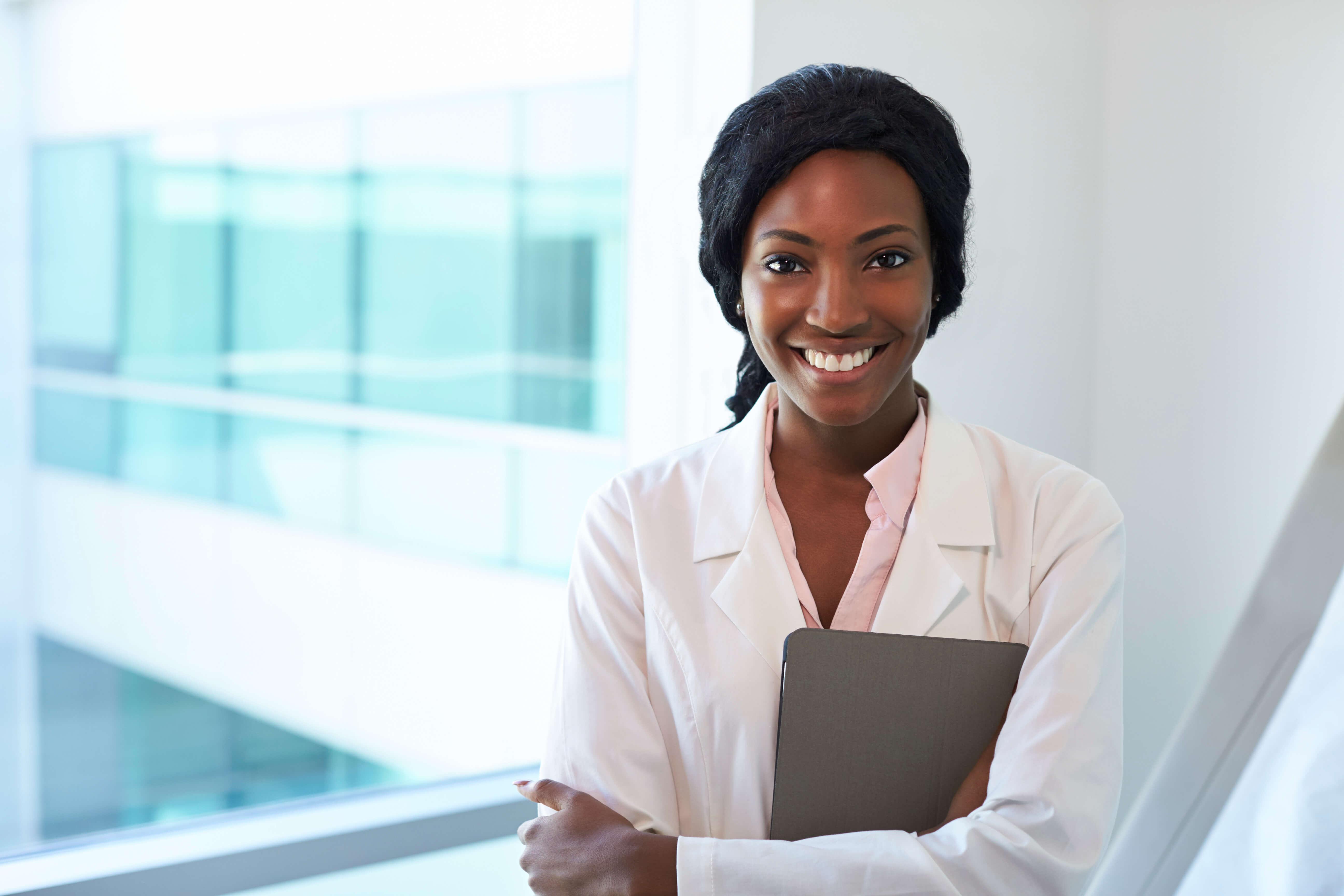 african american nurse smile telephonic triage advice hospital healthcare