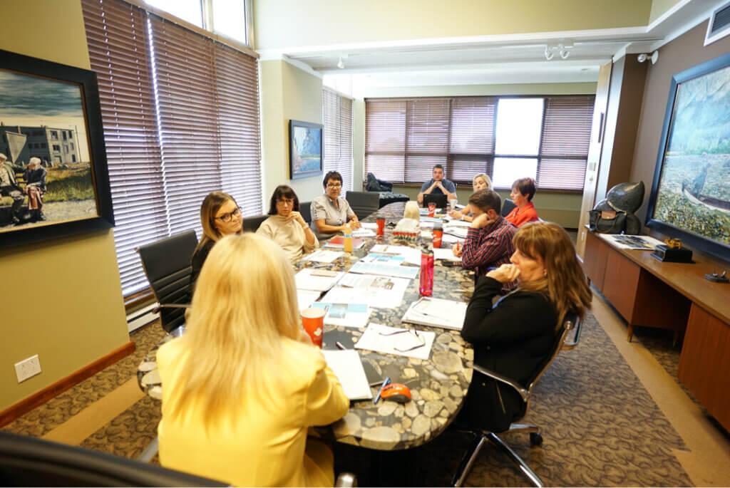 disease management program staff fonemed conference room table sitting talking telemedicine