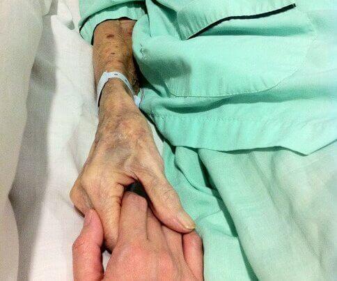 man holding hand disease management program