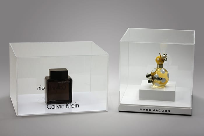 These custom perfume displays we manufactured to encase our clients products in clear acrylic are both eye catching and impactful helping them stand out in any setting, an important feature in custom retail displays.