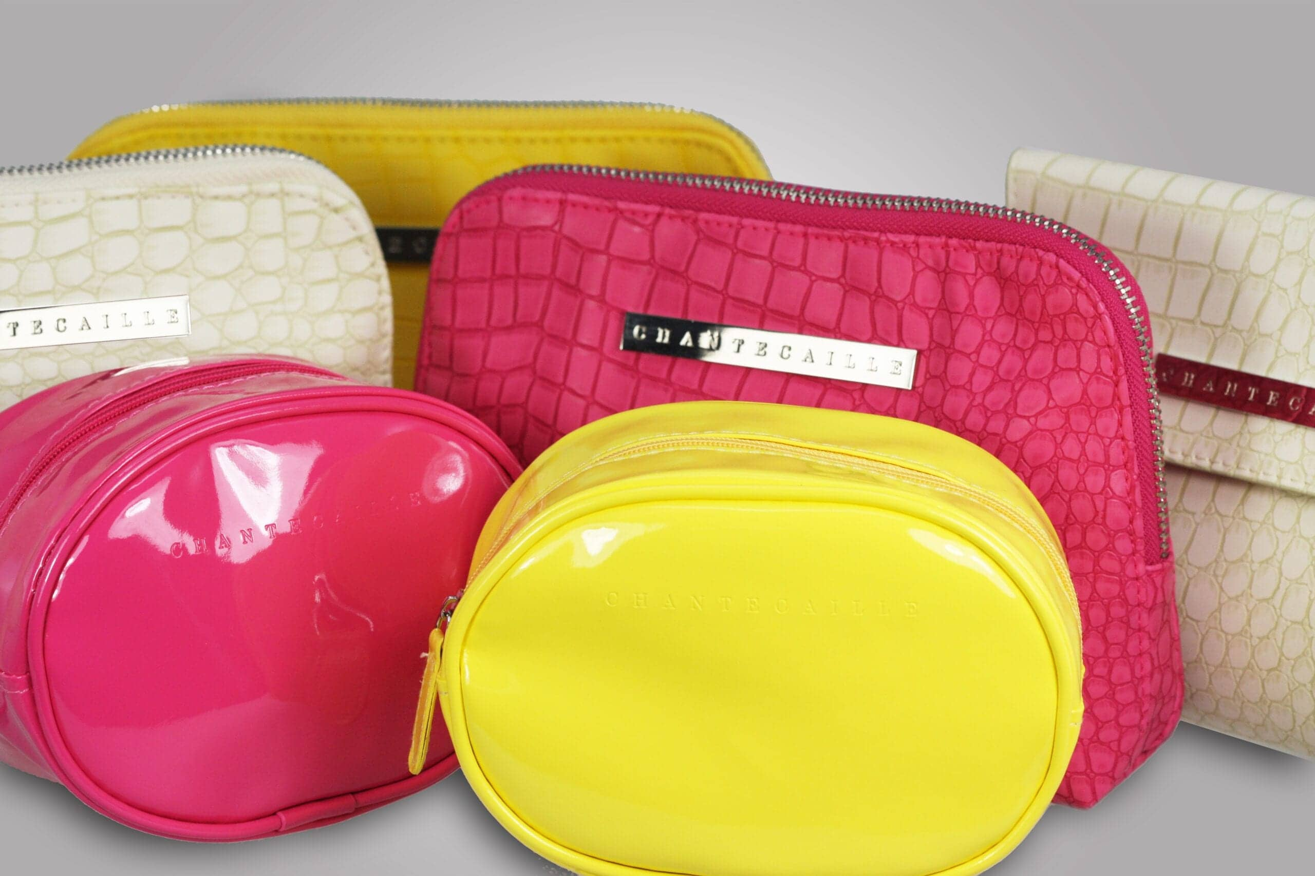 Promotional gifts also known as premiums, are a popular marketing tool to attract and maintain customers. PPD&G can custom make and manufacture any piece to fit your brand, like these colorful custom cosmetic cases.