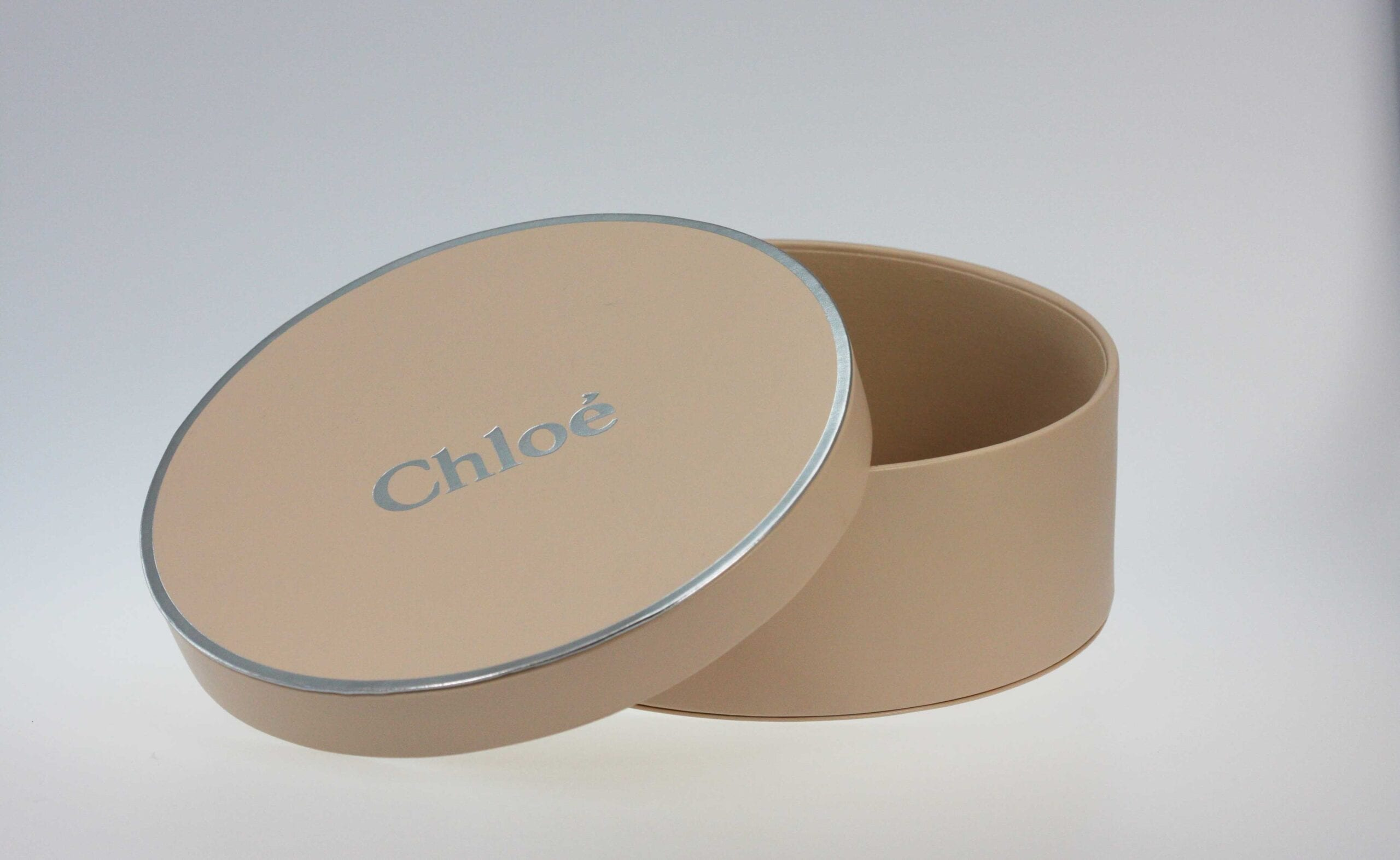 This simple yet classic custom round rigid setup box, designed to mirror a hat box exemplifies our commitment to excellence when it comes to custom packaging.