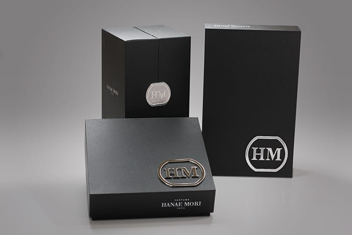 As experts in creating rigid setup boxes we know how to create custom packaging that generates excitement among potential customers like these elegant texture wrapped gift boxes, featuring a custom cast metal emblem.