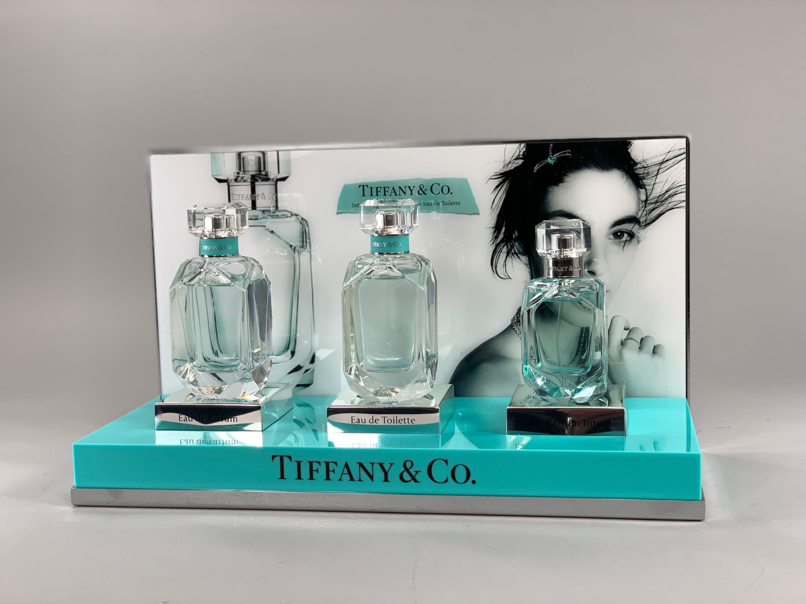 A custom in case enhancement, similar to this acrylic perfume display we created for a client, can help your product stand out from the rest in any retail setting.