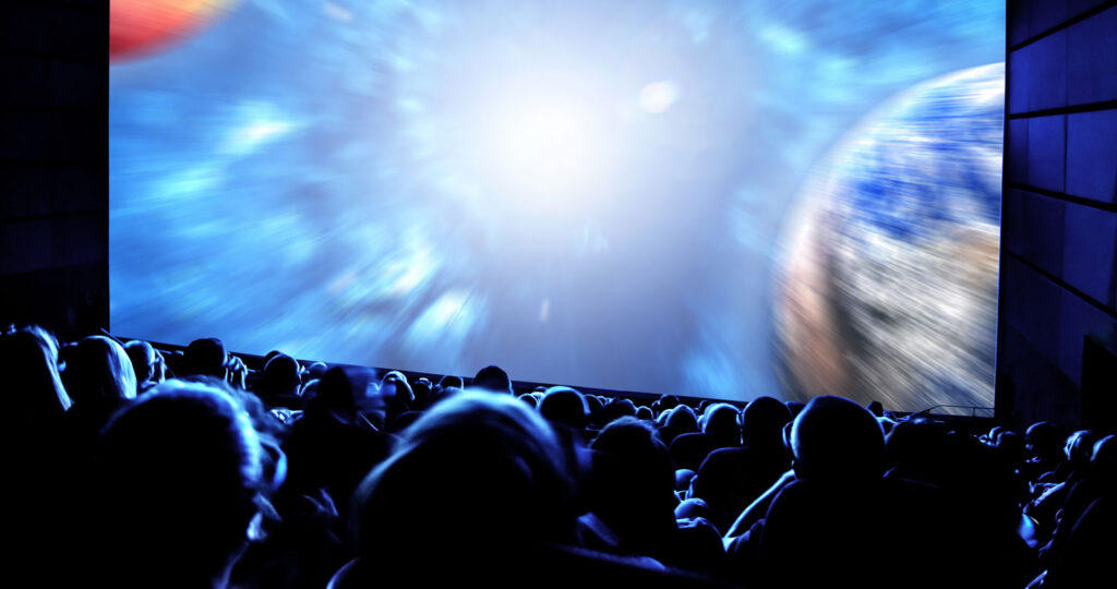 audience looking at space movie in a theater