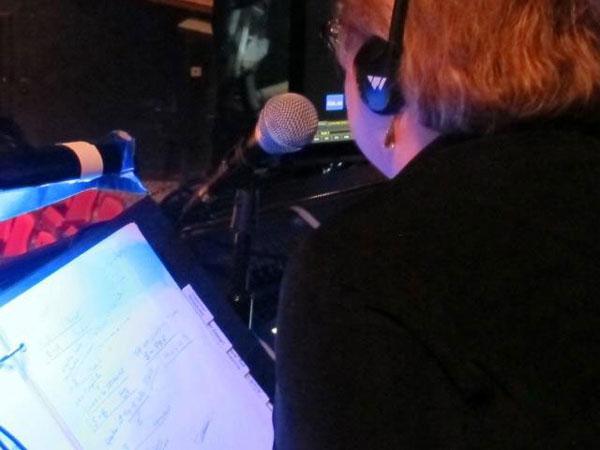 Deborah at the microphone