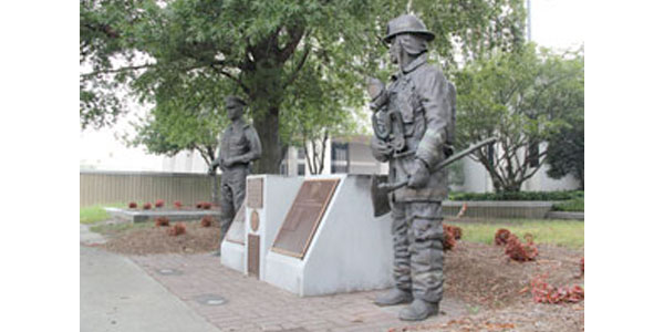 Memorial to Fallen Police Officers and Firefighters  Bronze and stone Figures by Neil Brodin Site: City Hall, 2400 Washington Avenue