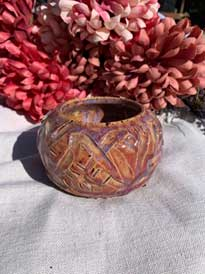 Textured ceramic bowl. Red/purple textured design 2.5 in tall 3 in diameter
