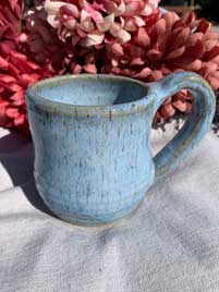 Ceramic Mug: Light blue glaze. 3in diameter 4in tall. $10
