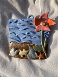 Ceramic hanging sculpture. Ocean creature and flower. 4x4