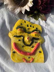 Yellow abstract face. Ceramic wall hanging