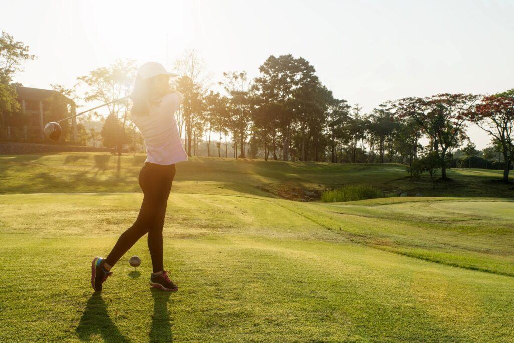 woman golfing in sun