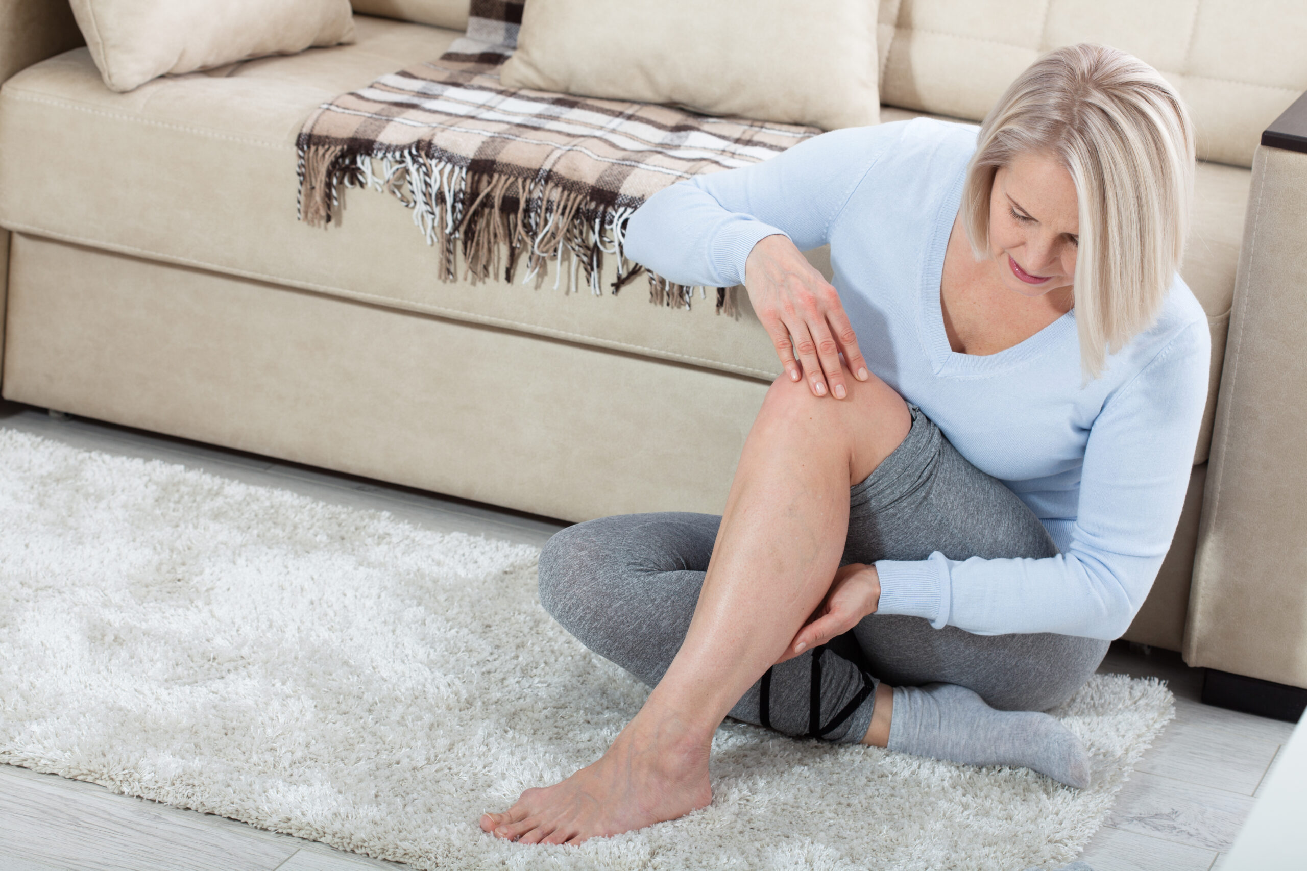 Middle-aged,Woman,Suffering,From,Pain,In,Leg,At,Home,,Closeup.